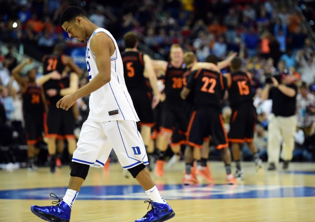 Dukes Quinn Cook walks off the court as Mercer -- and all non-Duke grads -- celebrates. (Bob Donnan, USA TODAY Sports)