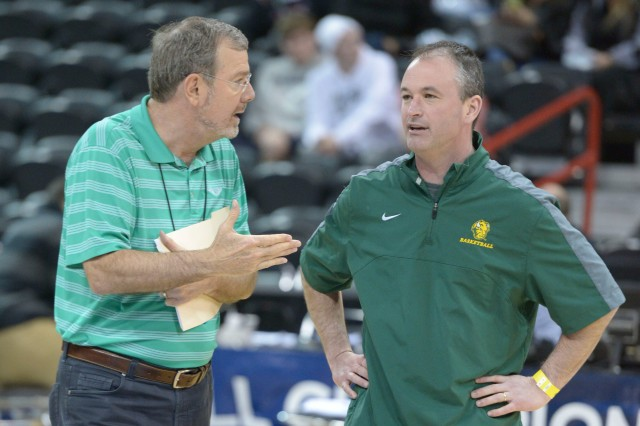 P.J. Carlesimo (left) talks to North Dakota State head coach Saul Phillips (right) during practice. The Bison are a trend upset pick. (Kirby Lee, USA TODAY Sports)