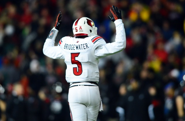 Louisville Cardinals QB Teddy Bridgewater, shown here playing against Cincinnati last season, has his pro day today. (Andrew Weber, USA TODAY Sports.)