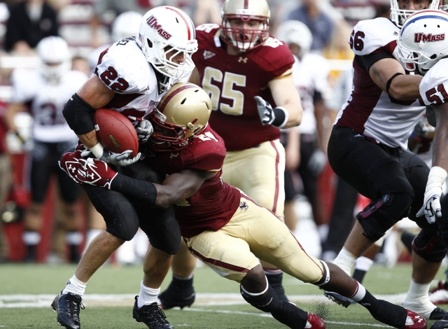 Boston College Eagles linebacker Kevin Pierre-Louis knocks the ball loose from Massachusetts Minutemen running back Jonathan Hernandez at Alumni Stadium. (Mark L. Baer - USA TODAY Sports)