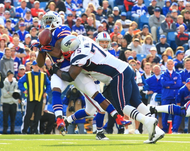 New England Patriots defensive tackle Vince Wilfork hits Buffalo Bills wide receiver Donald Jones on a pass play and knocks the ball loose at Ralph Wilson Stadium. (Kevin Hoffman - USA TODAY Sports)