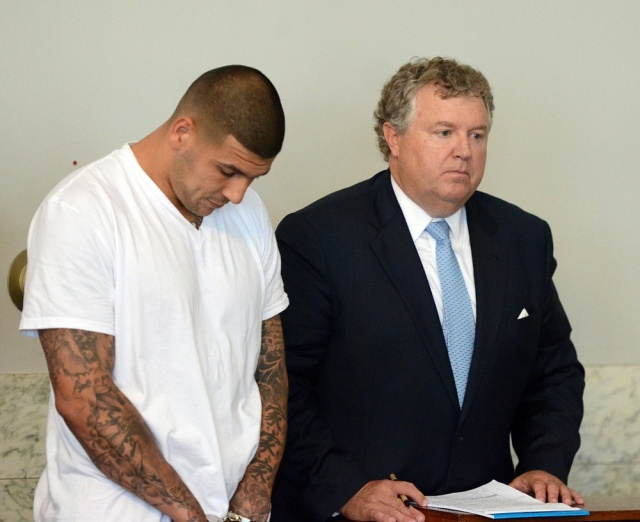 New England Patriots former tight end Aaron Hernandez (left) stands with his attorney Michael Fee as he is arraigned in Attleboro District Court. Hernandez is charged with first degree murder in the death of Odin Lloyd. (The Sun Chronicle/Pool Photo via USA TODAY Sports)