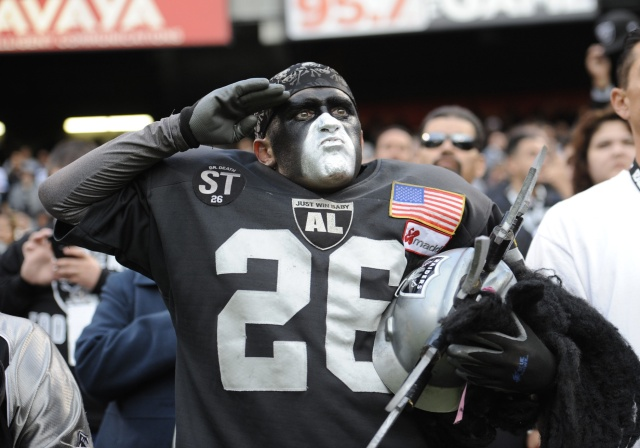 Fan in the Black Hole salutes during National Anthem in an preseason game between the Oakland Raiders and the Dallas Cowboys at O.co Coliseum. (Bob Stanton - USA TODAY Sports)