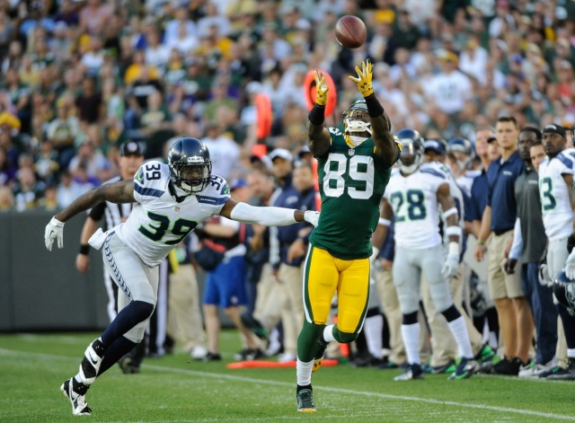 Green Bay Packers wide receiver James Jones can't make a catch against Seattle Seahawks cornerback Brandon Browner at Lambeau Field. (Benny Sieu - USA TODAY Sports)