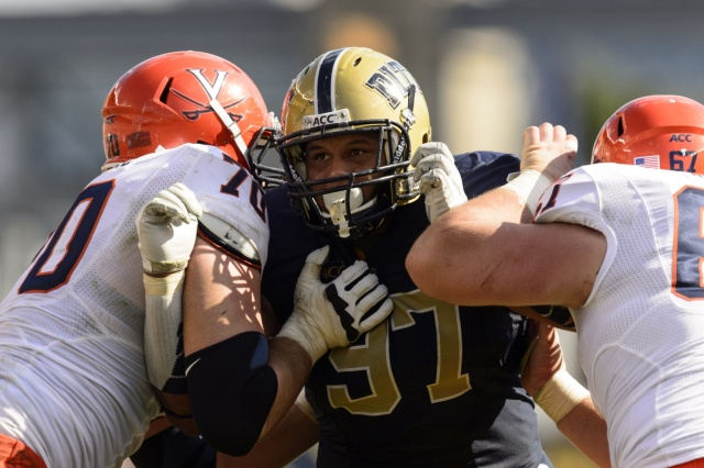 Pittsburgh Panthers defensive lineman Aaron Donald is blocked by Virginia Cavaliers offensive guard Luke Bowanko and center Jackson Matteo at Heinz Field. (Howard Smith - USA TODAY Sports)