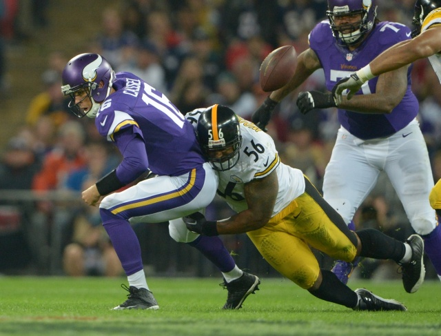 Pittsburgh Steelers linebacker LaMarr Woodley forces a fumble by Minnesota Vikings quarterback Matt Cassel in the NFL International Series game at Wembley Stadium. (Kirby Lee - USA TODAY Sports)