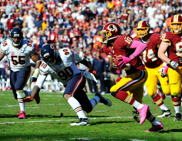 Julius Peppers (left) and Robert Griffin III (Brad Mills-USA TODAY Sports)