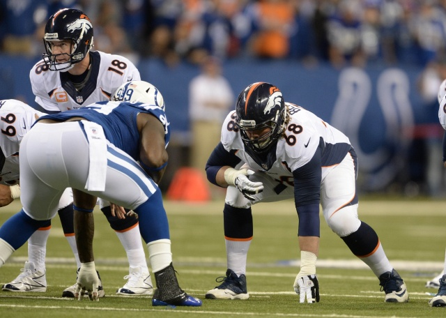 Denver Broncos quarterback Peyton Manning and guard Zane Beadles  against Indianapolis Colts at Lucas Oil Stadium. (Ron Chenoy - USA TODAY Sports)