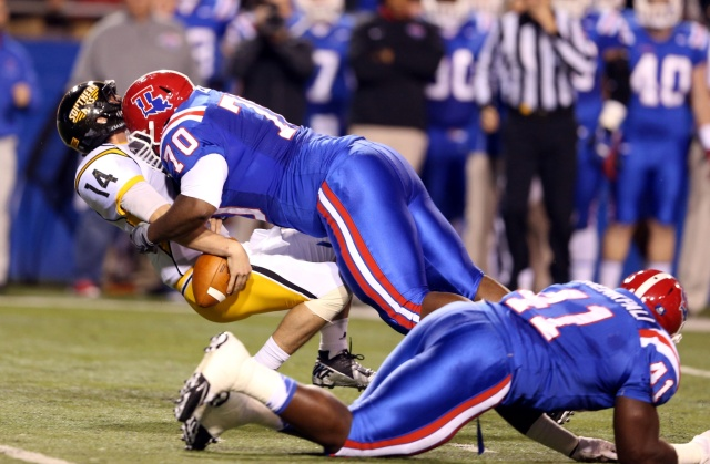 Southern Miss Golden Eagles quarterback Nick Mullens is sacked by Louisiana Tech Bulldogs defensive tackle Justin Ellis at Joe Aillet Stadium. (Chuck Cook - USA TODAY Sports)