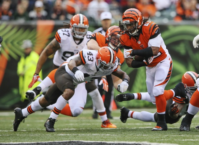 Cincinnati Bengals running back BenJarvus Green-Ellis runs with the ball as Cleveland Browns strong safety T.J. Ward defends. (Kevin Jairaj - USA TODAY Sports)