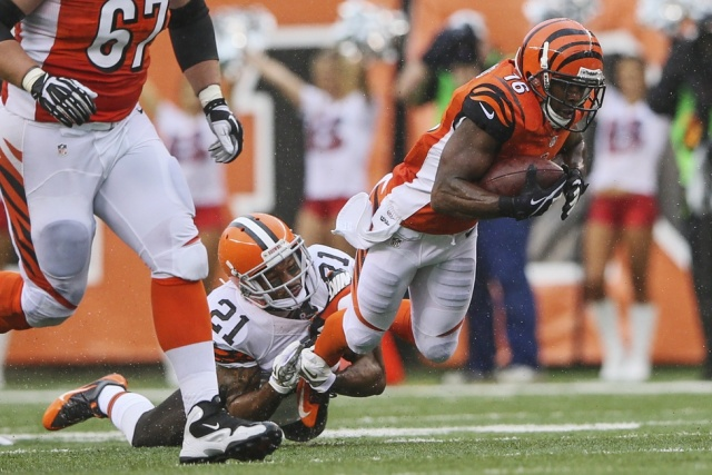 Cincinnati Bengals wide receiver Andrew Hawkins is tackled by Cleveland Browns cornerback Chris Owens at Paul Brown Stadium. (Kevin Jairaj - USA TODAY Sports)