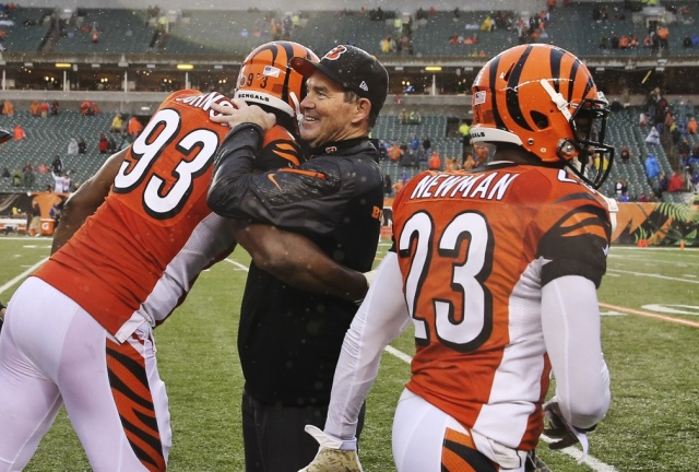 Cincinnati Bengals defensive end Michael Johnson hugs defensive coordinator Mike Zimmer during a game against the Cleveland Browns at Paul Brown Stadium. (Kevin Jairaj - USA TODAY Sports)