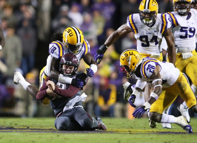 Texas A&M Aggies quarterback Johnny Manziel is tackled by LSU Tigers linebacker Lamin Barrow at Tiger Stadium. LSU defeated Texas A&M 34-10. (Crystal LoGiudice - USA TODAY Sports)