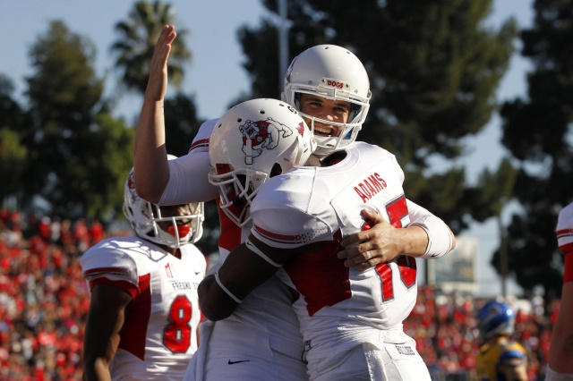 Fresno State Bulldogs wide receiver Davante Adams (15) is congratulated by quarterback Derek Carr (4) after scoring a touchdown against the San Jose State Spartans at Spartan Stadium. (Cary Edmondson - USA TODAY Sports)