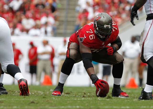 Tampa Bay Buccaneers center Jeremy Zuttah gets ready to hike the ball against the Atlanta Falcons at Raymond James Stadium. (Kim Klement - USA TODAY Sports)