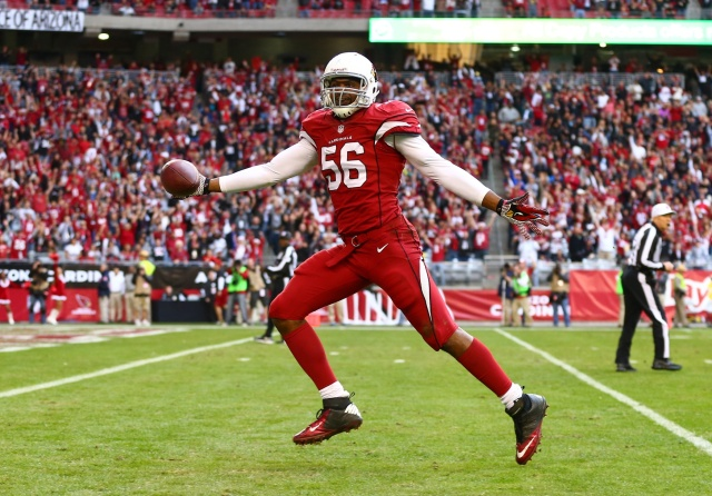 Arizona Cardinals linebacker Karlos Dansby returns an interception for a touchdown against the St. Louis Rams at University of Phoenix Stadium. (Mark J. Rebilas - USA TODAY Sports)