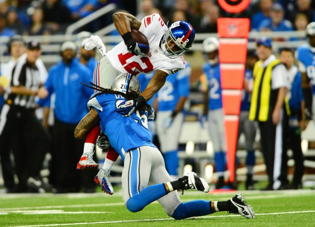 New York Giants wide receiver Jerrel Jernigan is tackled by Detroit Lions free safety Louis Delmas at Ford Field. (Andrew Weber - USA TODAY Sports)