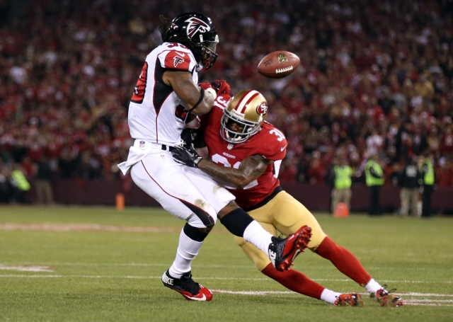San Francisco 49ers strong safety Donte Whitner is called for a penalty on the play against Atlanta Falcons running back Steven Jackson during the final regular season game at Candlestick Park. (Kelley L Cox - USA TODAY Sports)