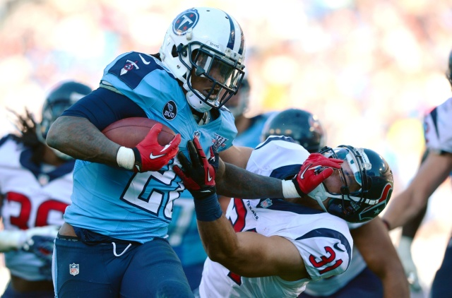 Tennessee Titans running back Chris Johnson runs with the ball to score a touchdown as Houston Texans safety Shiloh Keo attempts to tackle at LP Field. (Don McPeak-USA TODAY Sports)