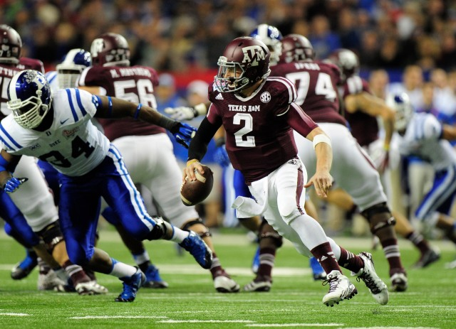 Texas A&M Aggies quarterback Johnny Manziel (2) runs the ball past Duke Blue Devils defense during the third quarter in the 2013 Chick-fil-A Bowl at the Georgia Dome. Kevin Liles-USA TODAY Sports.