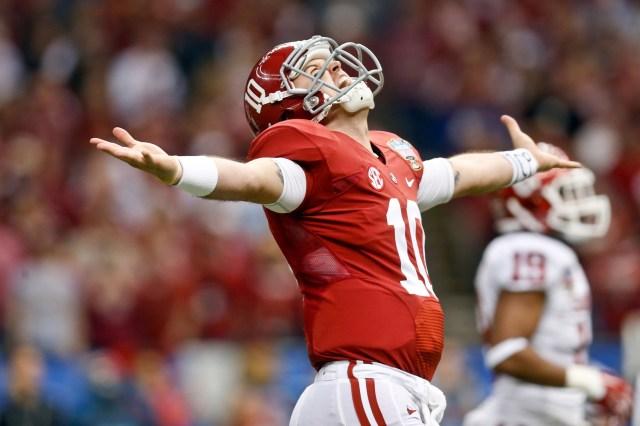 Alabama Crimson Tide quarterback AJ McCarron celebrates a touchdown against the Oklahoma Sooners at the Mercedes-Benz Superdome. (Derick E. Hingle - USA TODAY Sports)