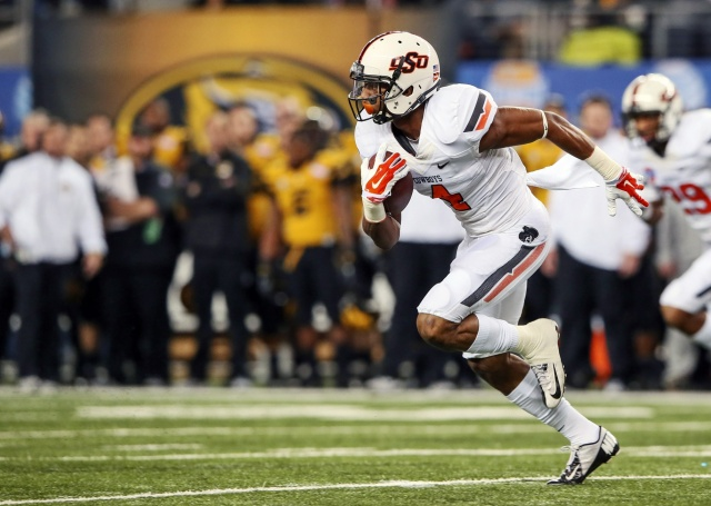 Oklahoma State Cowboys cornerback Justin Gilbert intercepts a pass and runs up the field against the Missouri Tigers. (Kevin Jairaj - USA TODAY Sports)