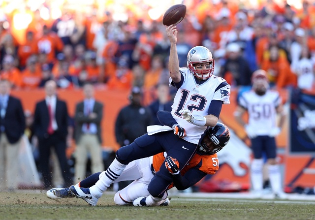 New England Patriots quarterback Tom Brady is brought down by Denver Broncos defensive end Jeremy Mincey in the second half of the 2013 AFC Championship football game at Sports Authority Field at Mile High. (Mark J. Rebilas - USA TODAY Sports)