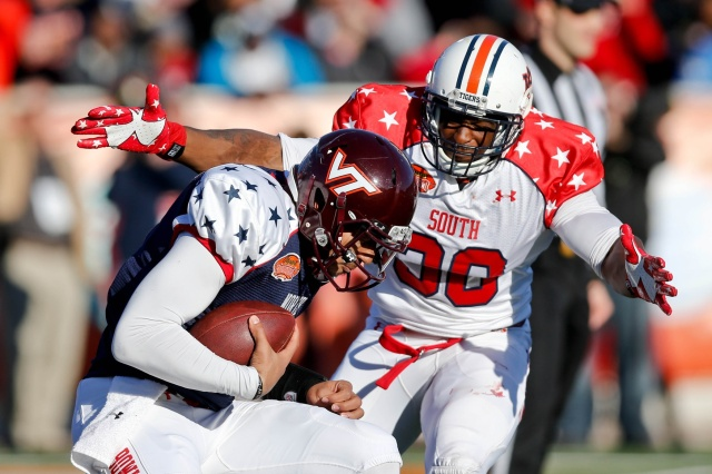 South squad defensive end Dee Ford of Auburn sacks North squad quarterback Logan Thomas of Virginia Tech during the first half of the Senior Bowl. (Derick E. Hingle - USA TODAY Sports)