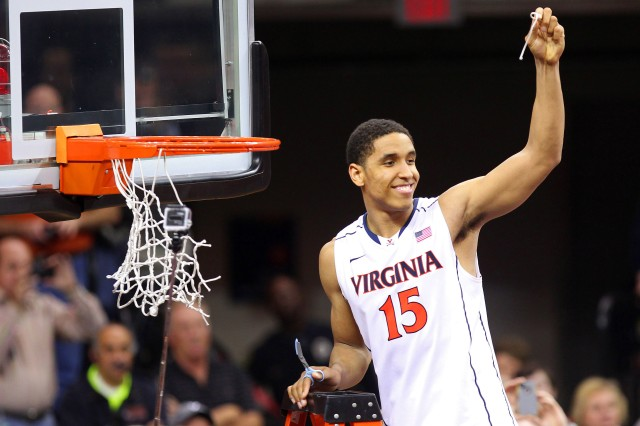 Virginia Cavaliers guard Malcolm Brogdon (15) celebrates by cutting the net after the Cavaliers game against the Syracuse Orange at John Paul Jones Arena. Geoff Burke-USA TODAY Sports.