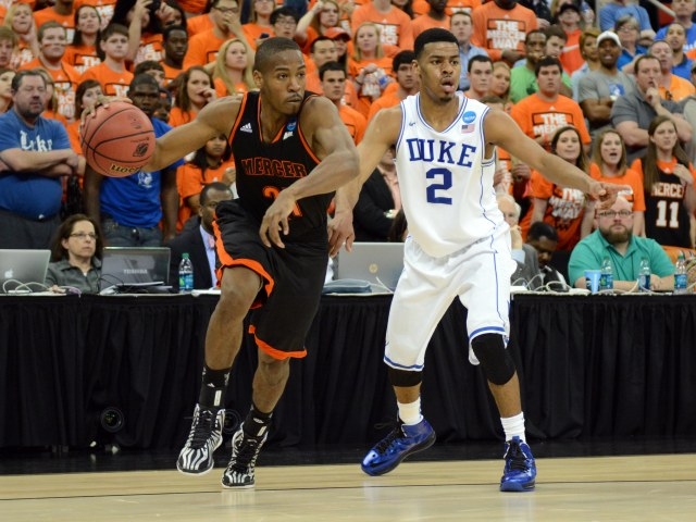 Mercer Bears guard Langston Hall (21) drives to the basket against Duke Blue Devils guard Quinn Cook (2) in the second half of a men's college basketball game during the second round of the 2014 NCAA Tournament at PNC Arena. Rob Kinnan-USA TODAY Sports.