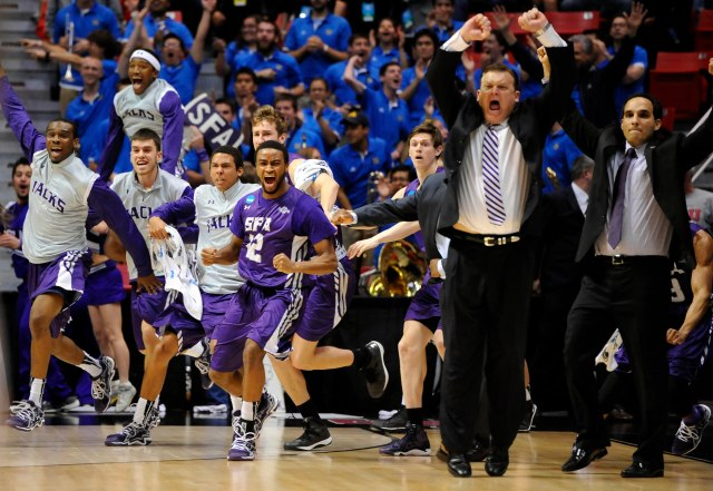 Stephen F. Austin rushes the floor in celebration after its victory against Virginia Commonwealth. (Christopher Hanewinckel-USA TODAY Sports)