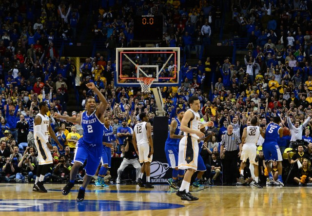 Kentucky Wildcats guard Aaron Harrison (2) celebrates as Wichita State Shockers guard Fred VanVleet (23) missed a three point shot with 1.6 seconds left in the third round of the 2014 NCAA Men's Basketball Championship at Scottrade Center. Kentucky defeated Wichita State 78-76. Jasen Vinlove-USA TODAY Sports.