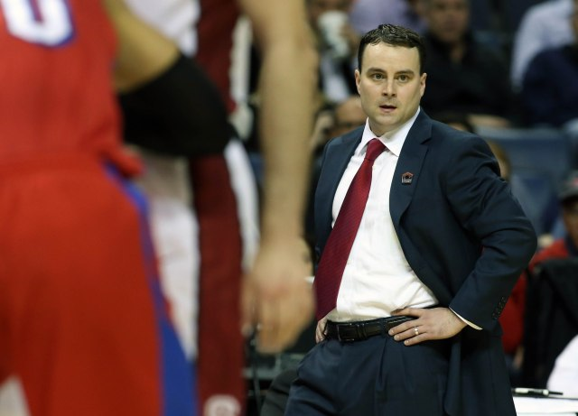 Dayton Flyers head coach Archie Miller watches from the sideline against the Stanford Cardinal during the first half in the semifinals of the south regional of the 2014 NCAA Mens Basketball Championship tournament at FedExForum. Nelson Chenault-USA TODAY Sports.