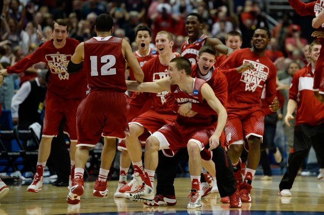 Wisconsin Badgers players celebrate after overtime in the finals of the west regional of the 2014 NCAA Mens Basketball Championship tournament against the Arizona Wildcats at Honda Center. The Badgers defeated the Wildcats 64-63.  Richard Mackson-USA TODAY Sports.