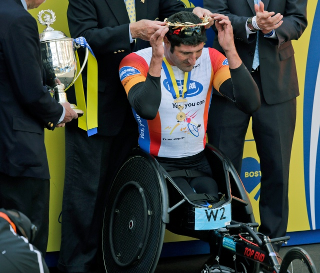Ernst Van Dyk, of South Africa, receives his victor's wreath after winning the men's wheelchair division of the 118th Boston Marathon. (AP Photo/Charles Krupa)