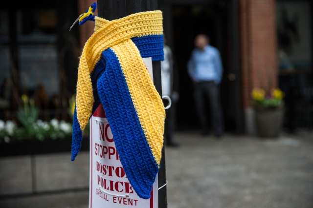 A knitted tribute hangs on a street light along the course of the Boston Marathon on the one year anniversary of the 2013 Boston Marathon Bombing.  (Photo by Andrew Burton/Getty Images)