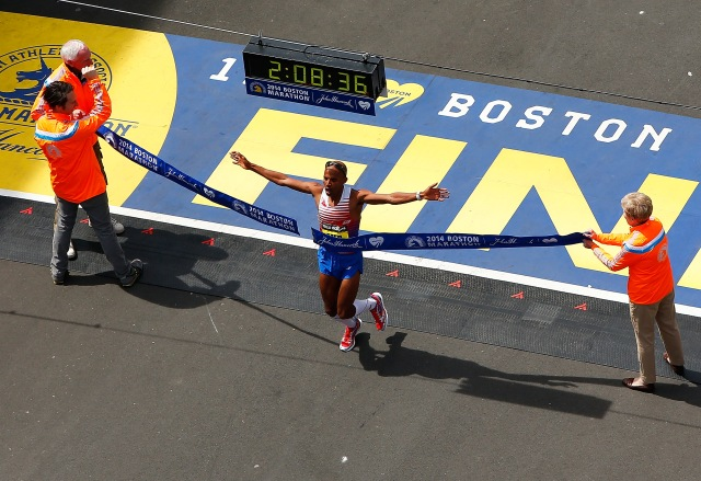 Meb Keflezighi of the United States crosses the finish line in first place to win the 2014 B.A.A. Boston Marathon on April 21, 2014 in Boston, Massachusetts. Meb becomes the first American winner of the Boston Marathon since 1983. (Photo by Jared Wickerham/Getty Images)