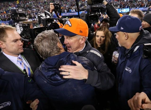 Denver Broncos head coach John Fox hugs Seattle Seahawks head coach Pete Carroll after Super Bowl XLVIII at MetLife Stadium. (Matthew Emmons, USA TODAY Sports)