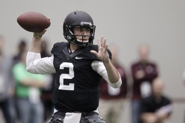 Johnny Manziel's pro day was an opportunity to market the quarterback. (Patric Schneider - Associated Press)