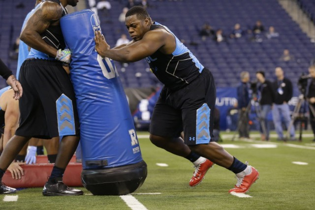 Princeton Tigers DE Caraun Reid works out at the NFL combine in Indianapolis. (Associated Press)