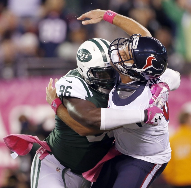 New York Jets defensive end Muhammad Wilkerson hits Houston Texans quarterback Matt Schaub as he releases the ball. (Andrew Mills/THE STAR - LEDGER via USA TODAY Sports)