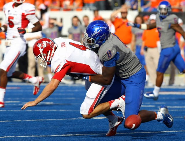 Fresno State Bulldogs quarterback Derek Carr fumbles the ball after being tackled Boise State Broncos defensive lineman Demarcus Lawrence at Bronco Stadium. (Brian Losness-USA TODAY Sports)