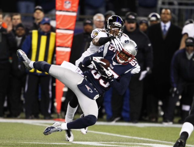Brandon Lloyd catches a pass as Baltimore Ravens cornerback Cary Williams  defends during the AFC championship game at Gillette Stadium. (David Butler II - USA TODAY Sports)