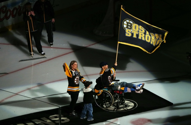 Boston Marathon bombing victim Marc Fucarile waves the Boston strong flag before game four of the 2013 Stanley Cup Final between the Boston Bruins and Chicago Blackhawks at TD Garden. (Greg M. Cooper - USA TODAY Sports)