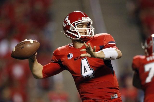 Fresno State Bulldogs quarterback Derek Carr prepares to throw a pass against the Boise State Broncos at Bulldog Stadium. (Cary Edmondson - USA TODAY Sports)