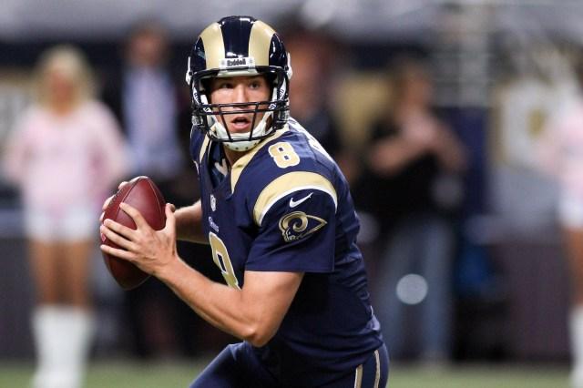 St. Louis Rams quarterback Sam Bradford looks to pass against the Jacksonville Jaguars at The Edward Jones Dome. (Scott Kane - USA TODAY Sports)