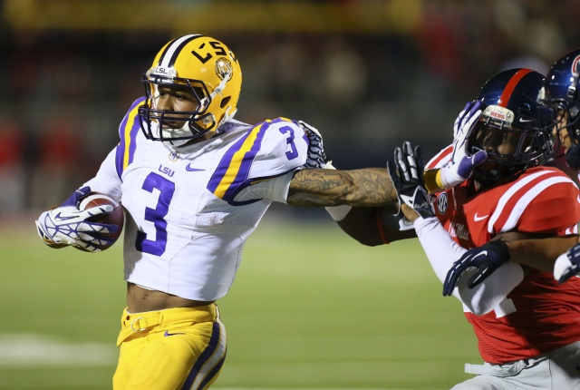LSU Tigers wide receiver Odell Beckham advances the ball and stiff arms Mississippi Rebels linebacker Keith Lewis at Vaught-Hemingway Stadium. (Spruce Derden - USA TODAY Sports)
