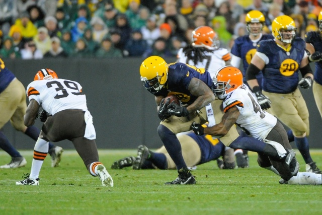 Green Bay Packers tight end Jermichael Finley is tackled by Cleveland Browns defensive back T.J. Ward and defensive back Tashaun Gipson at Lambeau Field. Finley was injured on the play and had to be taken off the field on a stretcher. (Benny Sieu - USA TODAY Sports)