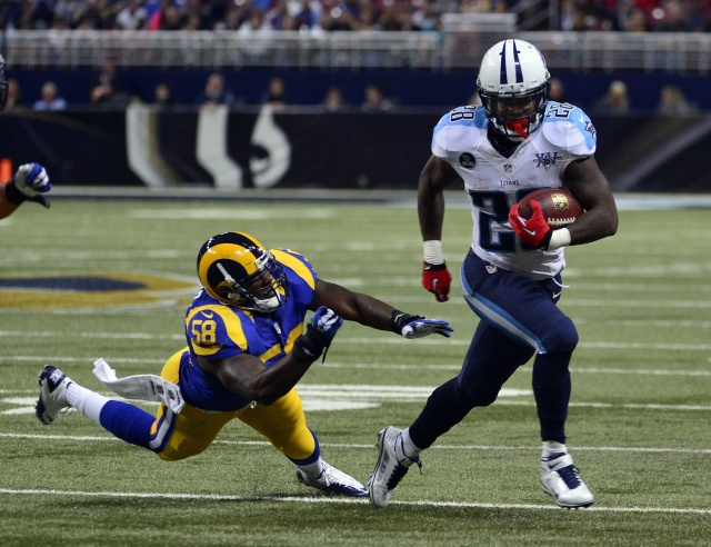 Tennessee Titans running back Chris Johnson breaks away from St. Louis Rams outside linebacker Jo-Lonn Dunbar at the Edward Jones Dome. (Scott Rovak - USA TODAY Sports)