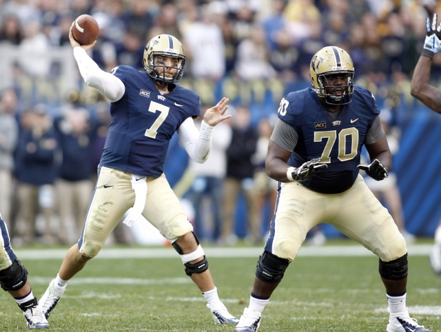 Pittsburgh Panthers quarterback Tom Savage passes under protection by offensive linesman Juantez Hollins against the North Carolina Tar Heels at Heinz Field. (Charles LeClaire - USA TODAY Sports)